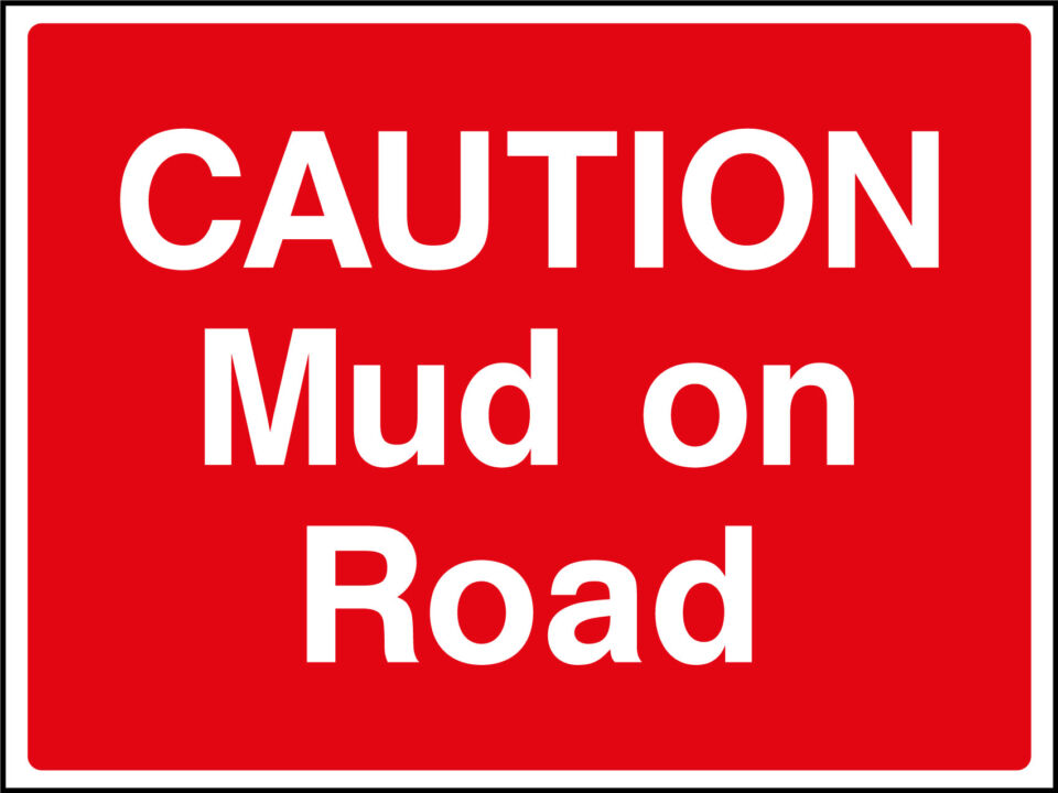 Mud on road sign