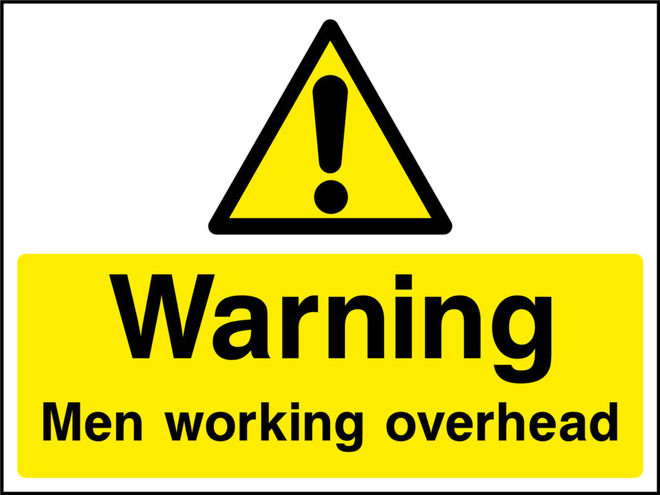 Men working overhead sign