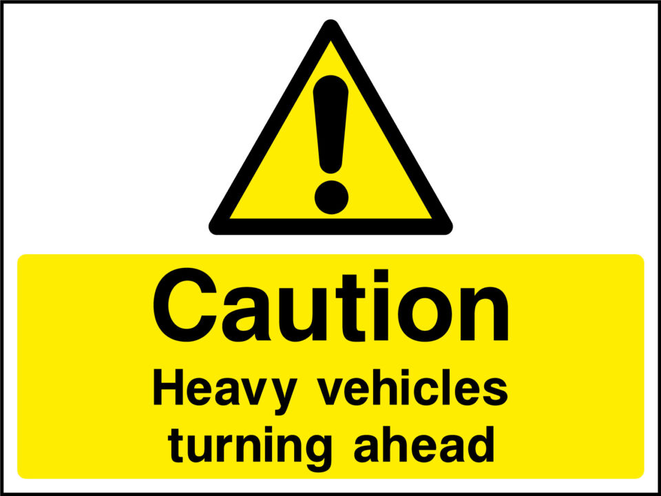 Heavey vehicles turning ahead sign