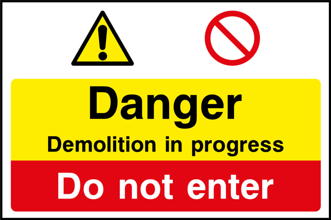 Demolition in progress sign